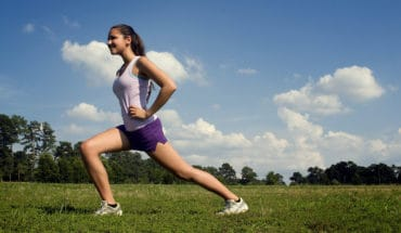 girl doing hip flexor stretches