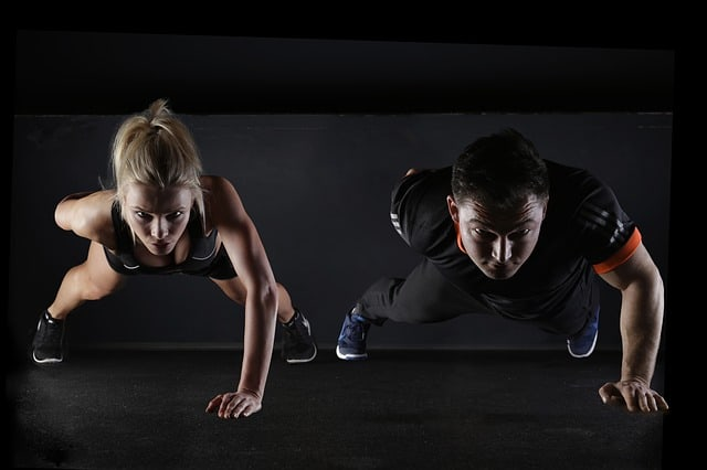 fit couple doing pushups