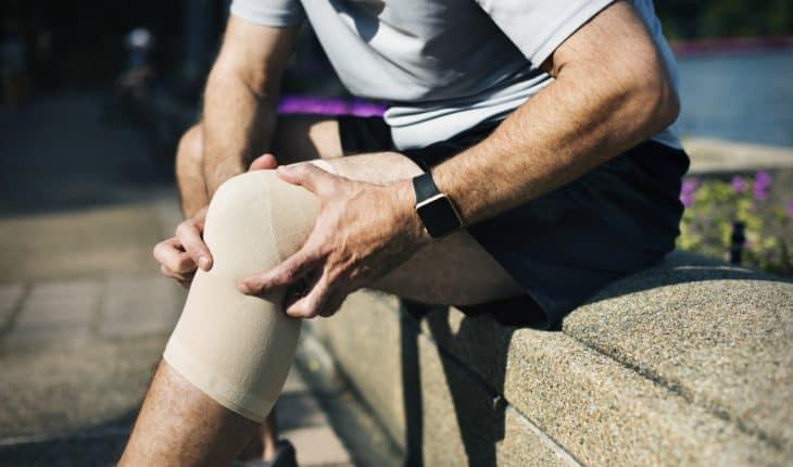 man with injured knee