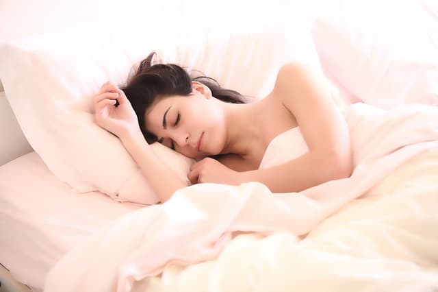 girl getting beauty sleep in bed